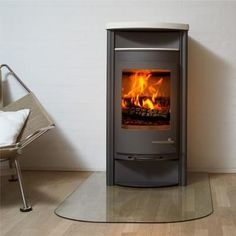 Contemporary Wood Stove from Wittus - Fire by Design, Model: Zeus Wedge-Shaped for Wall or Corner Use New Living Room, Home And Living, Wood Pellet Stoves, Conservatory Design, Building A House, Building Ideas, Wood Burner, Bed Sheet Sets, Platform Bed