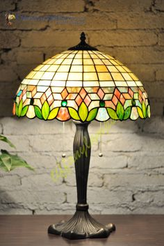 Tiffany Style Table Lamps, Tiffany Table Lamp suppliers including the famous Lilly, Wisteria, Mackintosh and floral designs. Tiffany Lamp Shade, Tiffany Chandelier, Tiffany Style Table Lamps, Tiffany Table Lamps, Stained Glass Lamp Shades, Tiffany Stained Glass, Glass Shades, Glass Painting Designs, Tiffany Art
