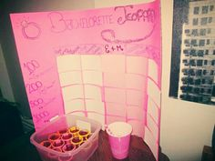 """Bachelorette Jeopardy! Bristoal board purchased at local dollar store, categories include: Here Comes the Bride, Our Favourite Groom, The Couple (in our case E+M), Wedding Trivia, and Let's Talk About Sex. If the team answered wrong there are """"punishments"""": 100 = sip your drink, 200 = boozy gummy bears, 500 = Jello Shot, 1000 = Bride decides, 2500 = Booze Shot. Such a fun game and so easy to make!"""