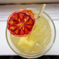 Pineapple, Ginger Beer and Vodka Cocktail garnished with Simple & Crisp Blood Orange