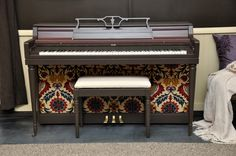 Piano revival with paint and upholstery on the kickboard.