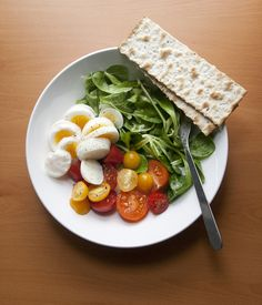 boiled eggs, matzah crackers, spinach and heirloom tomatoes. aka heaven on a plate
