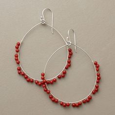 """LACY LOOP CORAL HOOPS--Swinging from silver earwires, wire-slender sterling silver hoops are delicately edged in loops of tiny coral beads. Made in the USA. Exclusive. 2-3/8""""L."""