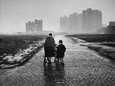 © Shirley Baker  Mother and Children Walk Along Deserted Cobbled Street