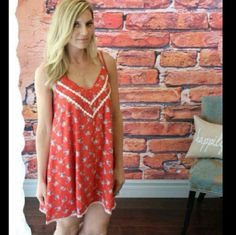 ✨HP✨  BOUTIQUE dress Super cute red floral pattern dress. Double adjustable straps.  Ivory Pattern at neckline and hem. Washed and worn 2 times and in great conditon. 65% cotton 35% polyester. Boutique Dresses Mini