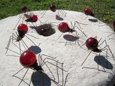 Spiders for your garden made from light bulbs and wire