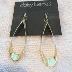 Brand new gold hoop earrings. Light weight and shiny! Daisy Fuentes Jewelry Earrings