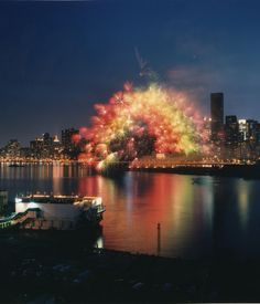 Cai Guo-Qiang, Transient Rainbow, Over the East River from Manhattan to Queens, New York, 15 seconds, Explosion radius approximately 200 m, 1000 Three-inch multicolor peony fireworks fitted with computer chips,