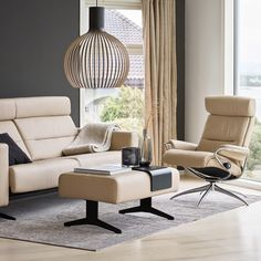 Placing a light-colored sofa (such as our Stressless® Stella pictured here in beige Paloma leather) against a dark-hued accent wall is an excellent way to make your furniture become the star feature of your room! Living Room Seating, Living Room Furniture, Stress Less, Danish Modern, Modern Living, Chairs, Walls, Layout, Sofa