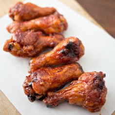 Crispy Baked Honey BBQ Wings Recipe Appetizers with chicken wings, flour, salt, garlic powder, chili powder, black pepper, cooking spray, barbecue sauce, honey, hot sauce, butter, garlic powder