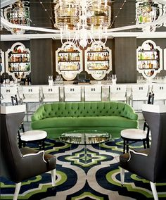 A trellis design on the rug in this  glamourous bar by Kelly Wearstler.