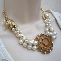 I have always loved the look of pearls. Use them with a big brooch and some old gold pieces. Good enough for a night out.