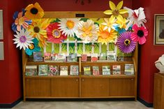 Inspired by the numerous giant flower  examples and tutorials on Pinterest and elsewhere on the web! Created a spring display for the library...