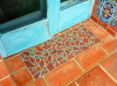 Welcome tile mosaic.  Love the idea and colors.