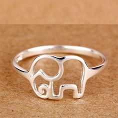 "Cute elephant design ring USA - UK - Mexico Ring sizes available in the last images  US ring size conversions to your country's conversion can be seen on the last image that shows ring size conversions. Click "" I DESERVE THIS"" To Order Yours!     NOT AVAILABLE IN STORES  925 Sterling SIlver"