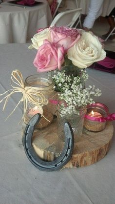Rustic wedding shower center pieces using all different sizes mason jars
