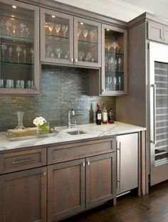 White granite countertops, dark finished non-glossy wood cabinets & stainless steal appliances…my farm house kitchen! :)