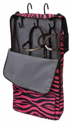 HorseLovers Trading Post -   Tough-1 Patented Print Halter/Bridle Carrier, $29.99 (http://www.horseloverstradingpost.com/english-saddles-tack/english-bridles-accessories/tough-1-patented-print-halter-bridle-carrier/)