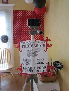 DIY photo booth : set up a backdrop wall, stick your camera on a tripod in front of it & let party guests create their own shots! Don't forget to provide a mirror for touch-ups beforehand and a basket of props – suit them to your party theme! | via Catch My Party