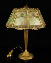 """1078 - Manhattan Brass Company Lamp Table lamp with original shade, made by the Manhattan Brass Company, marked M. B. Co., circa 1900, 25"""" h x 19"""" w. Provenance: from a Florida estate.  EST: $300 - $500 May 7th Estate Auction 