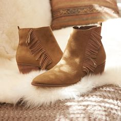 Kick it this #weekend in our Side Fringe Heeled Bootie.