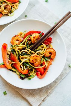 Have dinner ready in less than 20 minutes with this quick and easy zucchini noodle shrimp lo mein. It's loaded with veggies and perfect for busy weeknights.