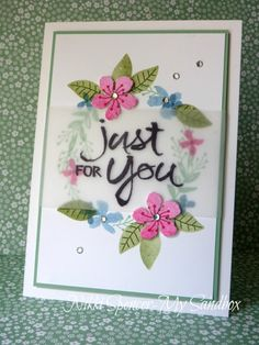 handmade card ... wreath of stamped and die cut flowers ... vellum band with  sentiment on top ... luv it!