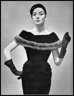 Model in black velvet cocktail dress, off-shoulder collar trimmed with band of mink, by Jean Dessès, photo by Georges Saad, 1956