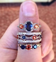 LOOK at our BEAUTIFUL selection of Orange and Blue rings. Perfect for graduation and any #AuburnUniversity fan! Available at #JewelryByDesignAuburn. Call us for details! 334-821-9940 #WarEagle #Gemstones #Diamonds