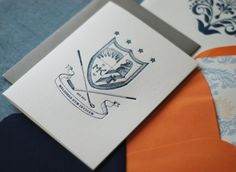 This couple designed a custom family crest for their invitation suite ... Way cool. Family crest by Serena Chang; Invitation design by Richie Designs