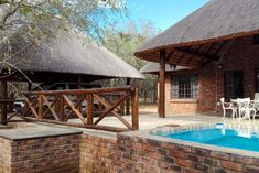 Escape - Accommodation in Marloth Park. Marloth Park Game Reserve And Bush Lodge Accommodation, Kruger National Park & Lowveld, Mpumalanga, South Africa Marloth Park, Kruger National Park, Game Reserve, The Locals, Gazebo, Beds, Butterfly, Outdoor Structures, Touch