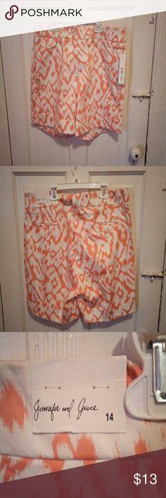Orange and white cuffed shorts Orange and white cuffed shorts with pockets. Great print. size 14 Jennifer and Grace Shorts
