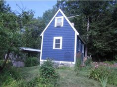 Check out photos of this 284-square-foot tiny house in rural New Hampshire. It comes with three acres of land and a barn for raising your own chickens.