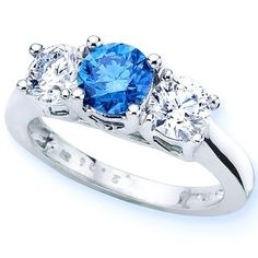 Blue Diamonds! Reminds me of trying one on in Tiffany's in LA. Could buys house for the price of blue diamonds