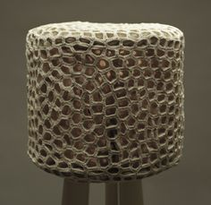 Monomoka | the wig A cotton lampshade formed from 348 crocheted shapes of white cotton thread which is mounted on a lacquered tripod.