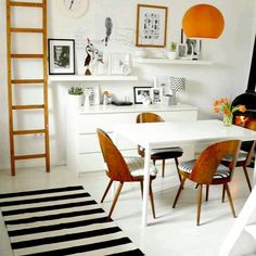 Cozy living room with Ikea 'Malm' drawers, 'Lack' shelves & 'Melltorp' dining table
