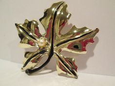 Hey, I found this really awesome Etsy listing at https://www.etsy.com/listing/190905841/vintage-1960s-maple-leaf-gold-tone