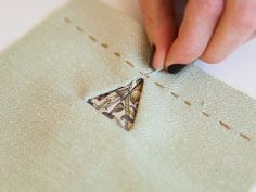How to sew a triangular bound buttonhole.  Professional Profile: Alison Smith  |  Seamwork Magazine