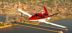 Cirrus Vision SF50 personal jet flying over its hometown of Duluth, Minnesota.