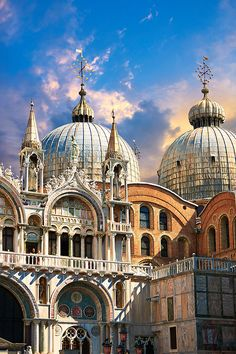 Facade with Gothic architecture and Romanesque domes of St Marks Basilica, Venice. Italy.
