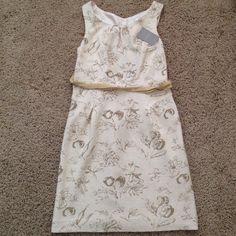 Cream printed sleeveless dress Cream Anthropologie printed dress. Cutout back and toe detail at waist Anthropologie Dresses