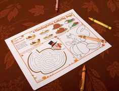Printed some Thanksgiving placemats and bought crayons for the kids table!