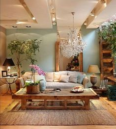 Loving the earthy hue of the walls and how the furniture pieces and added plant life enhance it all!