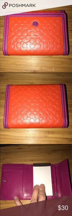 Coach Leather Notepad Orange and pink leather notepad.  Perfect to keep in your purse.  There is a pen mark on the inside, as seen in the last picture. Coach Bags