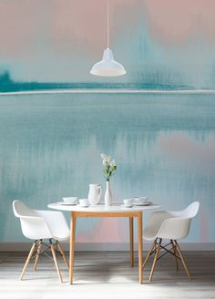 Lose yourself in this dreamy watercolour wallpaper mural. Depicting an abstract view of a still lake, this is a completely unique landscape that features stunning shades of coral and turquoise. Perfect for dining room spaces.