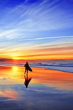 surfer in beach at sunsetbyMikel Martinez de Osaba