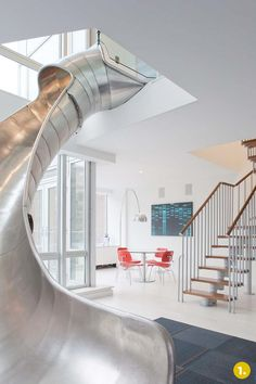 Another indoor slide ... more industrial than what we want though     credit: Turett Collaborative Architects [http://www.turettarch.com/projects/tca068]