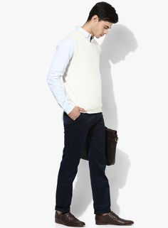 White in colour, this sleeveless sweater by Raymond displays a solid design for a classy effect. While the V-neckline amplifies the fashion appeal of this slim-fit sweater, the acrylic wool fabric assures optimum warmth. Wear it over a blue shirt along with black trousers and dress shoes.