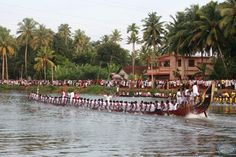 Oarsmen of snake boat teams participate in the Pumba Boat race in Thiruvalla, Kerala