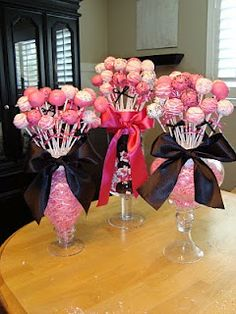 Cake Pop Display great for all types of parties so many ways to decorate add balloons ,toys endless ways be creative .  $1 store glass flower vase (different shapes & sizes to choose from) and candle stick glass holder from $1 store hot glue on bottom of vase glue both pieces  and add round piece of foam inside the vase to hold the pops and ta da  you have a cake pop display...... Also great for chocolate covered strawberries